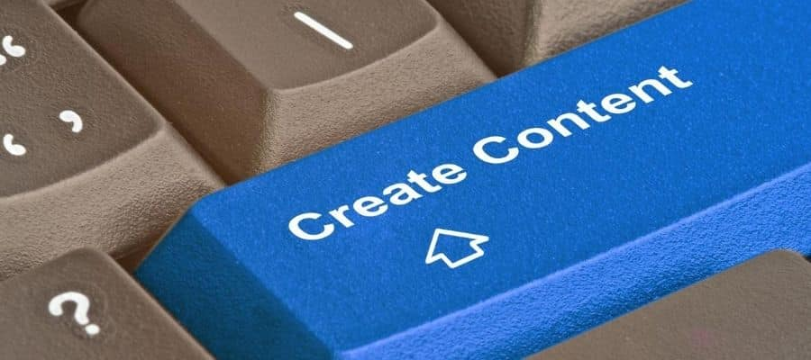 Close up of a keyboard with a large blue key titled 'create content'