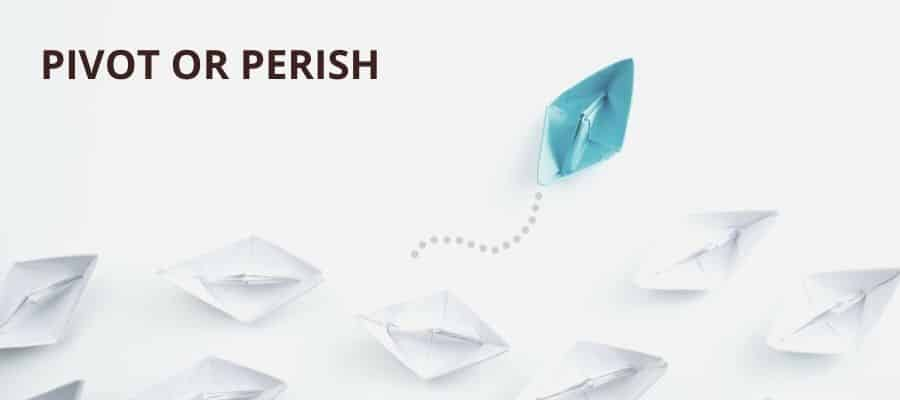 Pivot or perish - a collection of white paper boats with one blue boat veering off course