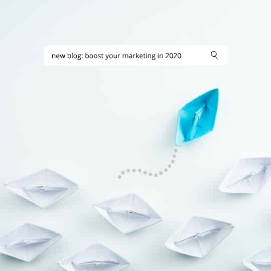 google search bar with the search term 'boost your marketing in 2020' above a collection of white paper boats. One blue boat is veering to a new direction